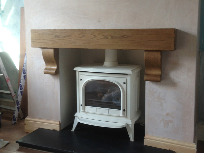cream gas stove with oak beam