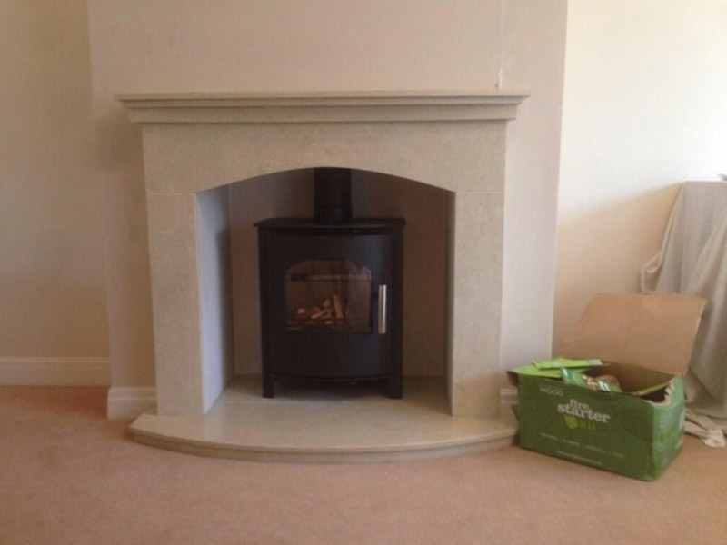 stove installation on marble hearth