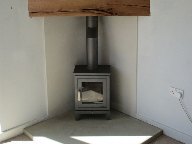 wood burning stove in corner installation