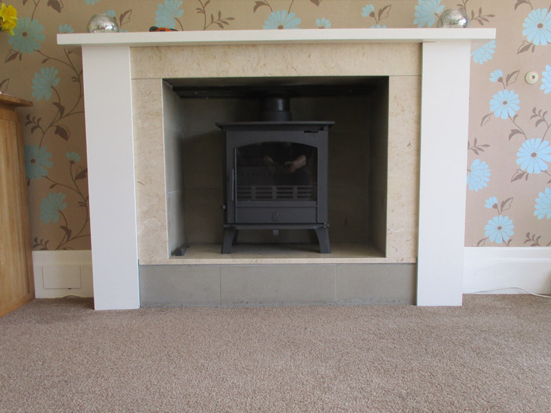 wood burning stove on a raised hearth