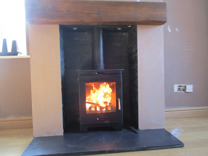 wood burning stove with slate hearth and stepped slate chamber